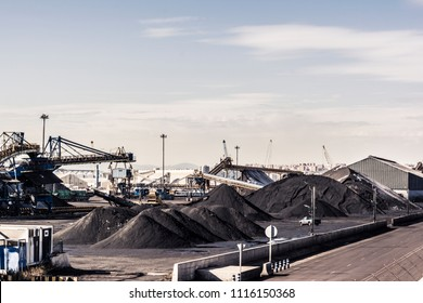 Large Stockpile of Coal in Tarragona port terminal, ready for railroad transportation to a thermal power plant
