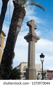 Large stone cross on a column