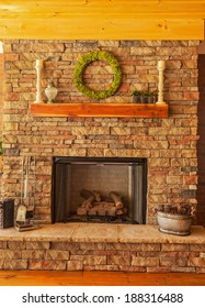 Large stone gas fireplace on interior deck