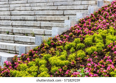 A large stone staircase. Landscape design, greening urban areas. Major European city. On the geographical border of Europe and Asia. Landscaped walking area. Vacation in Yekaterinburg.