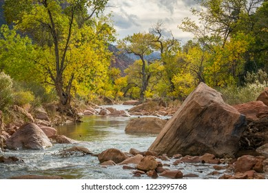 Large stones among water flow. The Virgin River flowing through Zion National Park, Utah, USA