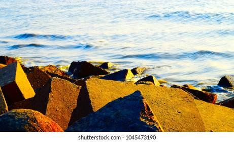 Large stones around a sea shore area isolated unique stock photograph