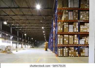 large storage room with shelves indoors blue orange