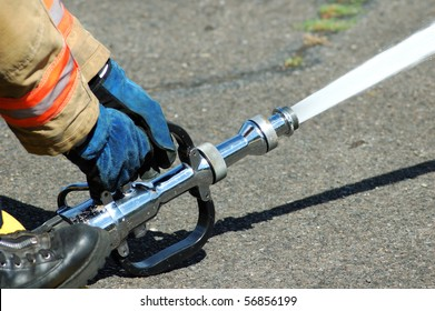 A large straight steam nozzle attached to a 3 inch hose for exposure protection at a structure fire.