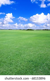 A large stretch of open, grass-covered land, closely mowed.