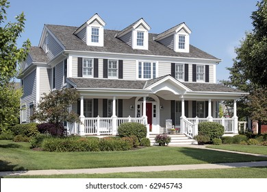 Large suburban home with front porch and arched entry