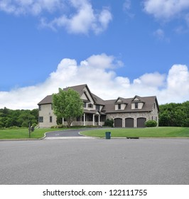 Large Suburban McMansion Home Trash Can Curbside Clouds Blue Sky Day Time