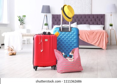 Large suitcases and bag packed for summer journey in room