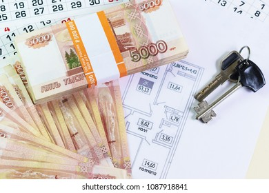 A large sum of Russian money and the keys are on the plan of the apartment. The leaves of the calendar. Time to buy