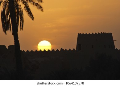 Large Sunset over Ad Diriyah historical watchtower and defensive wall in Riyadh. For Muslims, sunset signifies Maghreb time usually for breaking the fast and prayer time. Editable Clip Art.