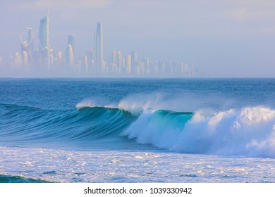 Large surf waves with Surfers Paradise Gold Coast citysape in the background