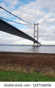 large suspension bridge, Humber Bridge – Barton-upon-Humber, Hull, England on a sunny day with white clouds in the sky.