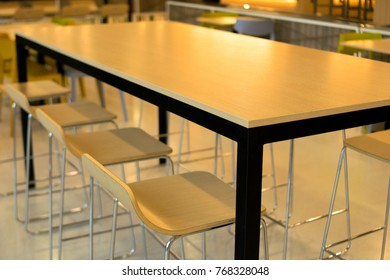 Large table and chairs with dining area.