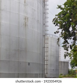 A large tank line near the Port of Tanjung Tembaga, Probolinggo - Indonesia, to store crude palm oil before distribution to cooking oil processing plants.