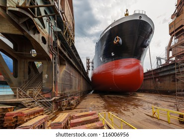 A large tanker ship is being renovated in shipyard Gdansk, Poland.