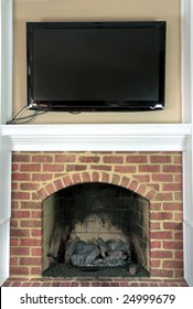 Large television hung over top of a gas fire place.