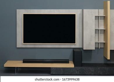 Gran pantalla de televisión en la pared de interiores modernos