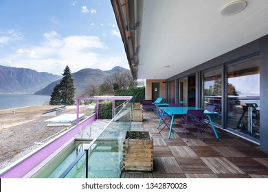 Large terrace with furniture and magnificent view of the lake. Sunny day