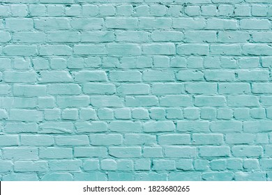 Large texture of light blue brick wall, textured surface. Brick background. Pastel blue brick wall. Turquoise painted old wide angle brickwork backdrop. Grainy texture