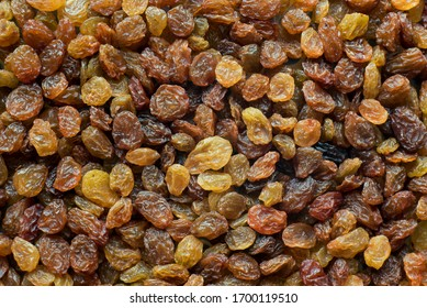 Large texture of light brown raisins, background.