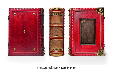 Large and thick aged red leather book with recessed wooden plate in the front cover, brass corners, rich decorated the spine part and closure straps.