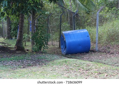 large thrown out blue barrel