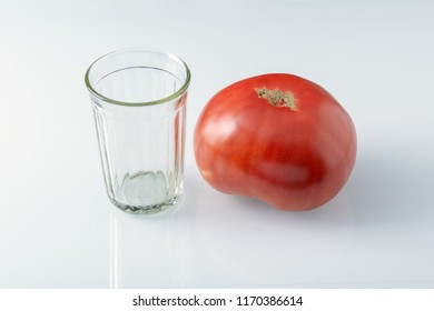 Large tomato and glass