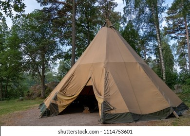 A large traditional teepee tent with luxurious glamping interior provides alternate but comfortable lodging for adventure seeking, outdoor loving tourists, or a eco friendly peaceful holiday retreat.