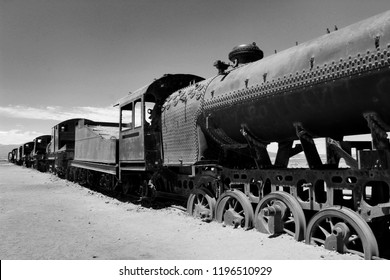 Large train graveyard, vintage metal cemetery, black and white photo with focal point in back, Uyuni, Bolivia