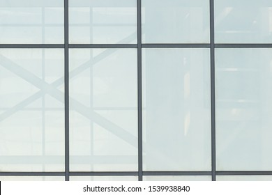 Large transparent light window of a business center, office or commercial building as a background or texture. Place for text