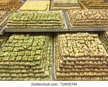 Large trays of baklava of different flavors