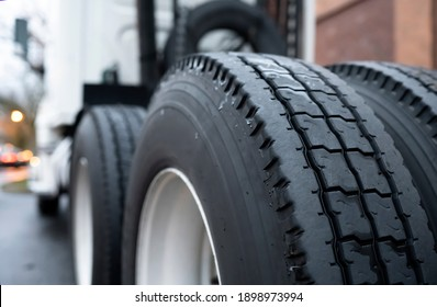 Large tread with grooves and special pattern for durable traction on big rig semi truck tractor tires on paired wheels ensures safe grip when transporting heavy cargo at any weather condition