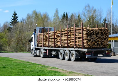 large truck with logs on the road