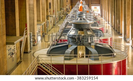 Large turbines spin to create electricity in the powerplant at Hoover Dam