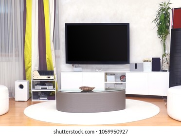 Large TV on the wall of modern living room interior
