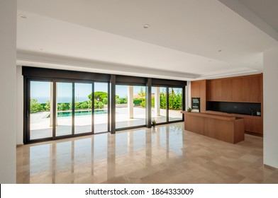 Large unfurnished living room with combined kitchen with modern furniture.