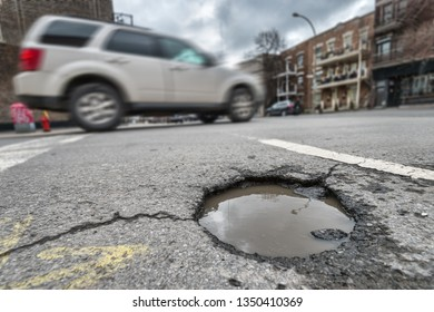 Large unrepaired pothole on Laurier street in Montreal, Canada (2018)