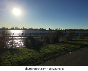 Large urban park and water with city skyline