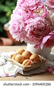 Large varietal pink peonies and apricots