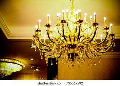Large Victorian chandelier hanging in a hotel lounge