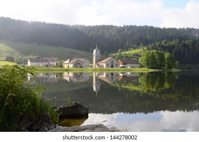 Large view of Abbaye lake and its abbey church, also known as Grandvaux lake, or Lake great river in Jura, France