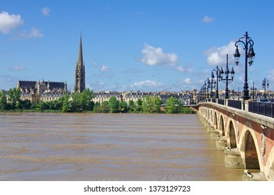 """Large view on Bordeaux town with Garonne river in the foreground and also """"Le Pont de Pierre"""". Famous stone bridge"""