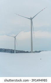 Large view on the windmill on the field in winter season