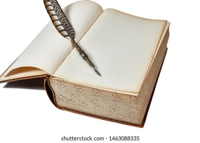 Large vintage book opened to a blank page with a quill pen laying on top of it isolated on white with shallow depth of field