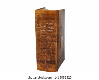Large vintage dictionary covered in leather isolated on white