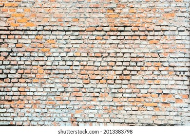 large vintage gray red weathered solid brick wall with cement for background