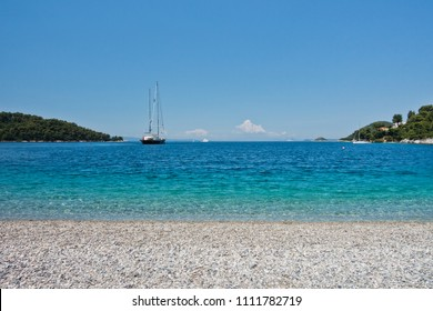 Large vintage yacht in front of Panormos beach at morning, Skopelos island, Greece