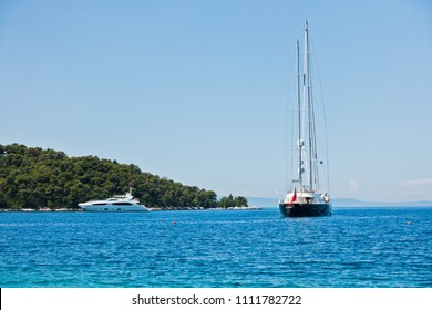 Large vintage yacht in front of Panormos beach at morning, Panormos bay, Skopelos island, Greece