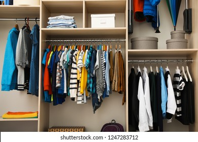 Large wardrobe with teenager clothes on hangers
