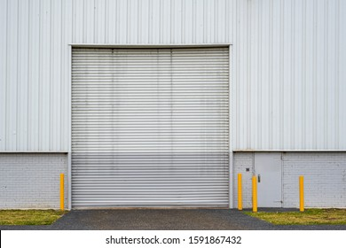 Large warehouse closed white rolling door with copy space